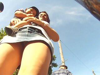 Hot upskirt views caught on the top of win in this world one's ride beside low-spirited babes